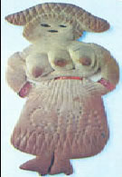 """Boneca feita de pão. Representa uma das """"deusas"""" (?) da fertilidade e das boas colheitas."""